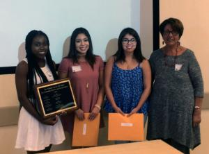 Dr. Yolanda García presents the Yolanda García Award for outstanding community service and social justice for the 2014-2015 school year to Olubukayo Akinyemi, Diana Cervantes, and Yaqueline Rodas. Each award grants $1,000.
